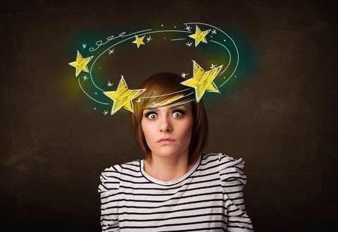graphic: woman with stars circling her head