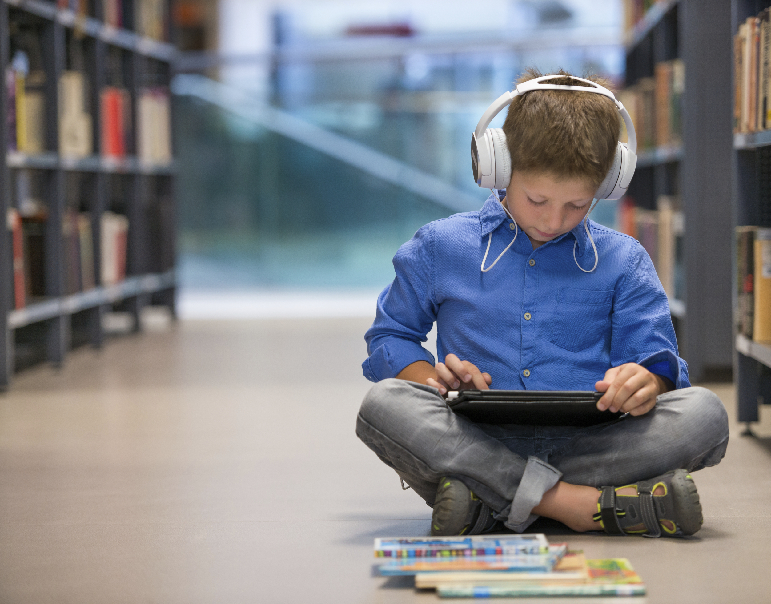 graphic: young boy listening to an audio book