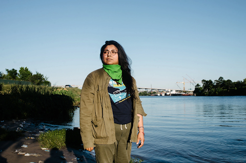 Yvette Arellano on the bank of Buffalo Bayou in industrial east Houston. Credit: Brandon Thibodeaux for The New York Times