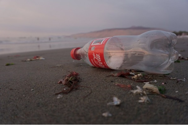 Picture of a Coca-Cola plastic bottle on a beach